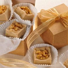 Maple Walnut*1 1/2 cups granulated sugar,2/3 cup (5 fl oz can) Carnation Evaporated Milk,2 Tb butter or margarine,1/4 tsp salt,2 cups miniature marshmallows,2 cups (12 oz pkg) White Morsels,1/2 cup chopped walnuts,1 1/2 tsp maple flavoring,48 walnut halves or pieces.Cook on medium heat butter,milk,sugar & salt.Remove from heat mix marshmallows & morsels til melted.Add flavoring.Top with walnuts.