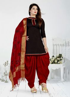 Get a collection of indian salwar kameez and salwar suits online. Order this cotton   black designer patiala salwar kameez for festival and party.