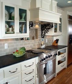 linen color cabinets, black countertops, greige subway tile - Google Search