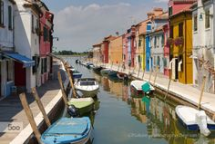 Burano; island in Venice laguna by bepenwilfrid  Burano boat boats colorful island italy light paint painted houses quiet reflection sea sky summer v