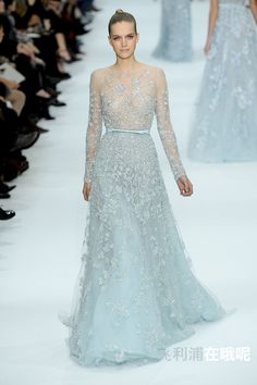 Elie Saab - Alta Costura - Primavera-Verano 2012 - Mirte Maas - http://es.flip-zone.com/fashion/couture-1/fashion-houses/elie-saab-2529 - Sky blue fully embroidered long sleeve gown with bow leather belt. @ Pixelformula