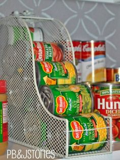 Flip a magazine file on its side to create the perfect home for a stack of cans that would otherwise roll off your shelf.