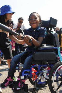 Tia Solomon, 9, of Coney Island laughs after hitting the ball during a softball clinic for disabled children at CitiField. It was part of the 14th Annual Major League Wheelchair Softball Tournament sponsored by the Mets, Major League Baseball and Wheelchair Sports Federation in the CitiField parking lot.