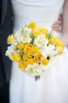Yellow flowers - Brides hand-tied posy with yellow roses, cream stocks, ivory gerbera and rosemary