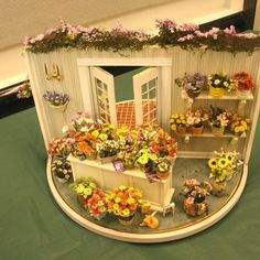 Exhibits from the Spring 2009 Seattle Dollshouse Show: The front and interior of…