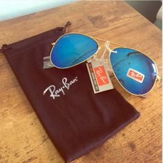 Blue reflective aviator sunglasses * Brand new with tags attached  * Will include protective drawstring sleeve  * Stamped on both arms and corner lens * 100% UV protection  * Classic and chic   * Please note that the drawstring sleeve may be different from exact one pictured Accessories Glasses