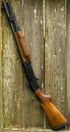 Mossberg 930 with wooden furniture.