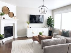 Corner fireplace, gray sofa, Macy's sofa, Radley sectional, tv console Home Fireplace, Living Room With Fireplace, New Living Room, Small Living Rooms, Home And Living, Living Room Designs, Modern Living, Tv With Fireplace, Living Room Decor With Tv