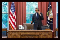 Pres Obama talks on the phone w Oklahoma Gov Mary Fallin on Monday in the wake of deadly tornado that killed more than 50 people. (Photo tweeted by White House photographer Pete Souza.)