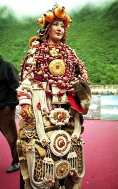 Tibetan lady wearing an incredibly expensive and heavy ceremonial costume during the King Gesar Arts Festival / Khampa arts festival in the Kham region of Tibet in 2004.