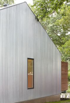 Kansas-Architecture-Students-Wrap-Affordable-Home-in-Corrugated-Metal-02
