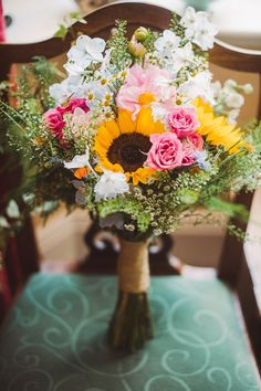 Wildflower and sunflower wedding bouquet. Photography by Razia N Jukes
