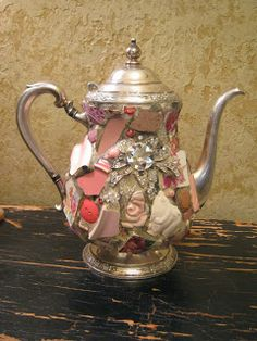 Pink mosaic teapot with sparkly brooch.