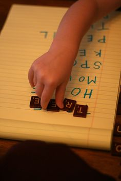 use scrabble tiles to help your child learn letters :)