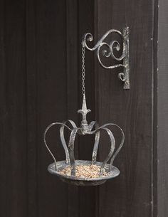 Unusual and beautiful bird feeder with whimsical character and exquisite detail. http://shop.pallensmith.com/gifts/hanging-crown-bird-feeder/