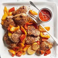 Moroccan Chicken And Peppers. Harissa, a North African chile paste, gives this dish a depth of heat.