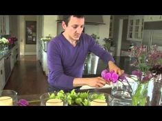 This holiday season, if you wish to make your dining area as festive as the rest of your home, a holiday centerpiece made with candles and flower decorations can add grace and sophistication to your Christmas dining table. In this Pottery Barn video, Floral Designer and Author Nico de Swert demonstrates how to make an attractive dining centerpie...