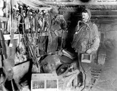 A mine rescue station in Flanders with a sapper ready for descent and other equipment prepared for use. IWM