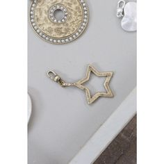 Accessorise your look this season with this gorgeous star charm, featuring crystal details.  Ideal to be worn with plain chains, metal beaded bracelets and necklaces.  Available in Light Antique Silver.  Material:  Made from a mixture of metals - nickel free plating Height:  4.2cm, Width:  2.5cm