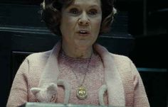 "They find Umbridge presiding over an inquisition, the locket round her neck. ""She's like a giant ball of cotton candy possessed by the demon azazel"""