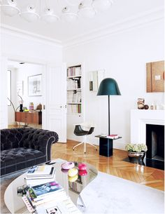 Inside an Eclectic Parisian Pad// mirrored coffee table, chesterfield sofa