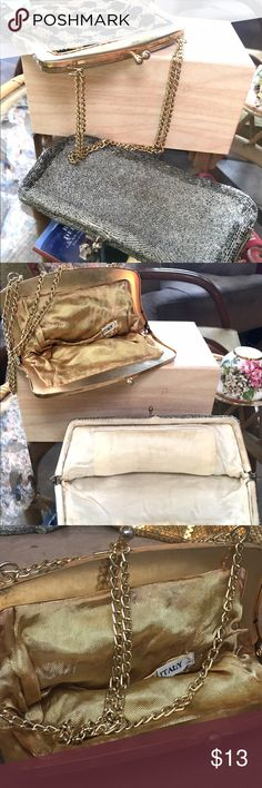 """🌻Two Vintage  Purses🌼♥️ This vintage Purse/clutch Lot is a rare one. The black and gold with handle is made in Italy 7""""x6"""" circa 1972 and has a few hanging stands easily fixed by a clever seamstress, the silver clutch 8""""x5"""" is nameless and dates back to the mid 1960's! Thank you for shopping my closet today!🎶🐢👒 Bags Clutches & Wristlets"""