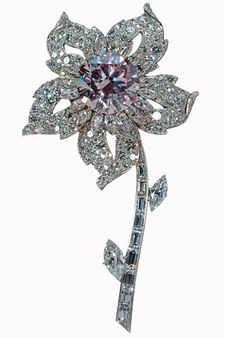 Her Majesty Queen Elizabeth II Brooch - Crafted in the shape of an alpine rose, the Williamson Diamond Brooch features a remarkable 23.6 carat pink diamond