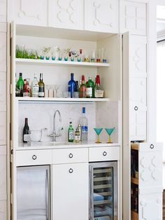 Built-in bar is concealed behind wood paneling.  Designer Skip Sroka's Own Home - Traditional Home.  Photos by Werner Straube.