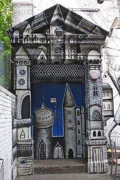 Decorated doorway by British artist Phlegm #phlegm #streetart #doorways #art #murals