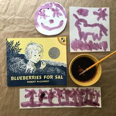 Picture Book Art Activity: When you think about activities to make Blueberries for Sal come alive for young readers, you automatically think about recipes: from pancakes to muffins, pie to even sauces, blueberries are perfect for so many things. But anyone who has ever dropped blueberries on their pristine summer white clothes knows that blueberries have the perfect inky purple-blue juice to make paint!  Drawing inspiration from the blue-black ink of the books's illustrations, this activity…