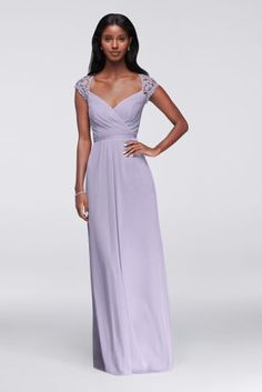 The bodice of this long mesh bridesmaid dress is a thing of beauty: It features a faux surplice front,