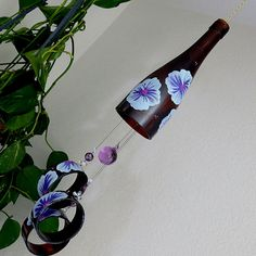 Wine bottle wind chime, Recycled glass bottles, yard art, patio decor, brown glass, Lt blue and Purple flowers by LindasYardArt on Etsy