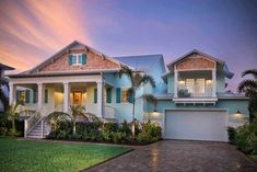 Bright and cheery, this beach cottage (plan ) is defined by its hi-flying ceilings with transom windows and expansive outdoor living. Cottage Style House Plans, Beach House Plans, Beach Cottage Style, Coastal Cottage, Coastal Homes, Cottage Plan, Cottage House, Coastal House Plans, Coastal Farmhouse
