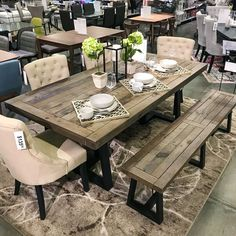 Hudson ding table Farmhouse chic dining set. Upholstered dining chairs with tufted decoration. Wooden bench matching table. Farmhouse style with modern updates.