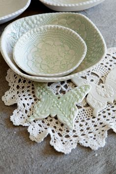 doilies used for texture in clay. I love doing this...these are gorgeous!