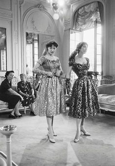 Mark Shaw. Two Dior models pose in metallic dresses for buyers, 1953.