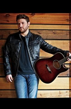 Chris Young - find me a boy like him and I'll let my walls down; gentle man, family man, sensitive, strong, country boy and just a down right sweet heart!