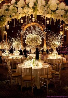 Obviously, this would be ridiculously expensive. But it gives me the idea that we could hang a ball/topiary above each table to give it height (if they let us) and then have shorter centerpieces. That means people can talk across and between tables, and it'll be less expensive than a lot of tall centerpieces.