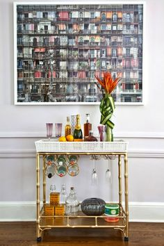 An article featuring some amazing bar carts and listing the most important ingredients/tool to have (I so want a bar cart someday/rightnow...)