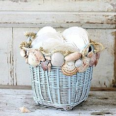 Show off your seashell treasures with a simple diy project. Glue seashells to a light colored basket and add sisal rope as an accent.