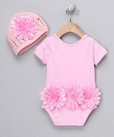 This pretty pink bodysuit and crocheted beanie are tutu-rrific thanks to sweet, soft material. The frolicsome flower on the beanie matches the one on the back of the suit. Convenient snap closures invite any little darling for a dance to remember!Includes bodysuit and beanie95% cotton / 5% spandexHand wash