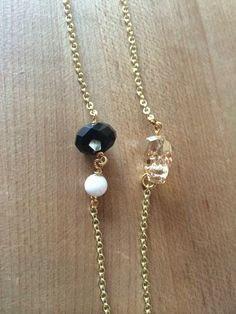 Chain #31. The Erin Swarovski crystal and white jade on a gold chain.