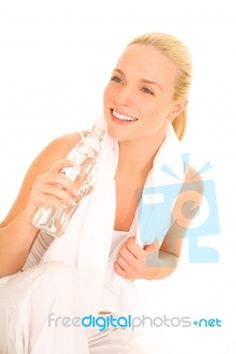 Woman Holding Bottle With Towel looks really good
