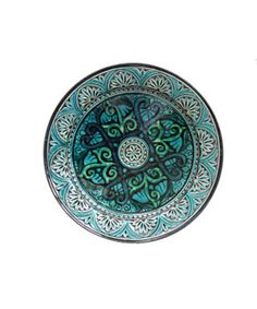 Enhance your home decor with this decorative Moroccan plate. Featuring intricate engravings and repetitive designs, Safi style pottery is a fine example of traditional Islamic art.  Moroccan pottery dates back over one thousand years  Made using centuries old techniques  Created by master artisans of Safi, Morocco