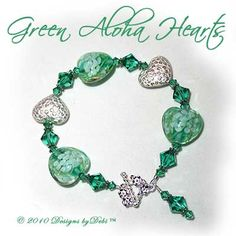 Designs by Debi Handmade Jewelry Green Aloha Hearts Green Glass Hearts, Bali Silver Floral Heart Pillows and Swarovski Crystal Light Emerald Bicones Bracelet with a Sterling Silver Square Floral Toggle Clasp ~ SOLD