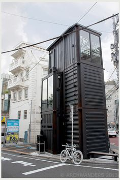 Barista Pro Shop, one from the chain of Streamer [Coffee] Company is a very unusual cafe. Situated in the district of Harajuku, Tokyo, Japan this building stands out due to it's resemblance of a shipping container tilted vertically. I was not sure if it was a real shipping container used for the construction, but after closer examination, I discovered  that it is only a design solution.