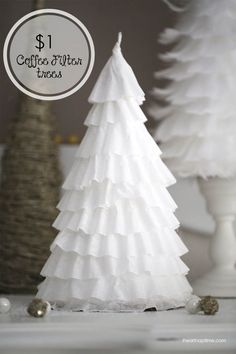 DIY coffee filter trees ...make these gorgeous Christmas trees for less than a buck! Add a few candles for an awesome centerpiece.