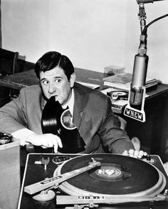 Buddy Hackett with records and turntable
