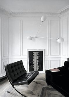 Puristic and minimalistic Interior of a living room. Excellent Symbiosis of classic with modernity.