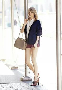 White shirt, navy cardi, burgundy shorts, beige bag and laced heals - sophisticated and cute